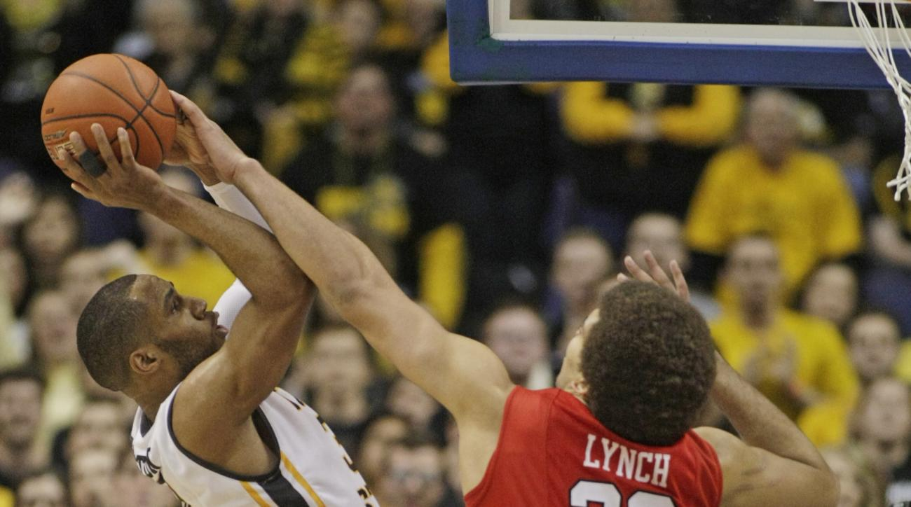 Illinois State's Reggie Lynch (22) blocks a shot from Wichita State's Evan Wessel (3) in the second half of an NCAA college basketball game in the semifinals of the Missouri Valley Conference tournament, Saturday, March 7, 2015, in St. Louis. Illinois Sta