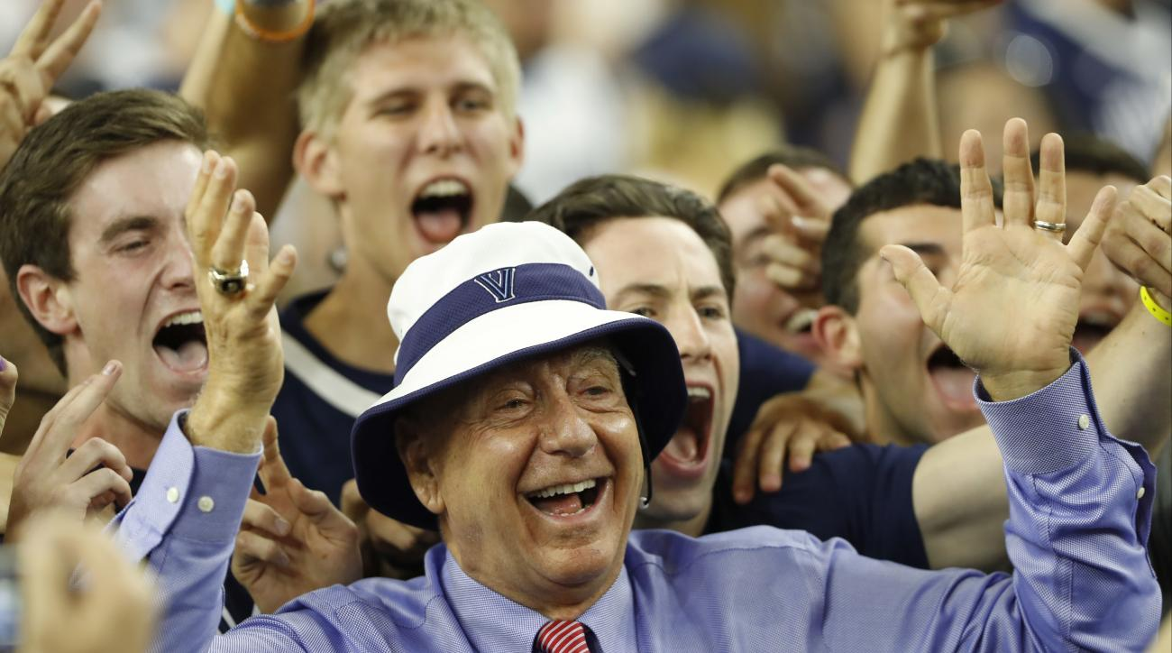 FILE - In this April 4, 2016, file photo, sportscaster Dick Vitale poses with Villanova fans before the NCAA Final Four tournament college basketball championship game between Villanova and North Carolina, in Houston. If you're a college basketball fan im