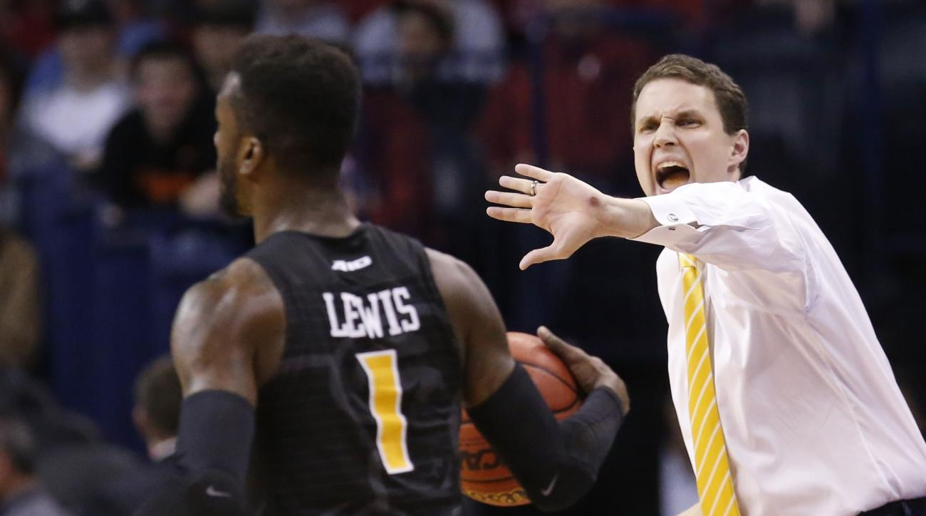 FILE - In this March 18, 2016, file photo, Virginia Commonwealth head coach Will Wade shouts to guard JeQuan Lewis (1) in the second half of a first-round men's college basketball game in the NCAA Tournament, in Oklahoma City. Wade's whirlwind first seaso