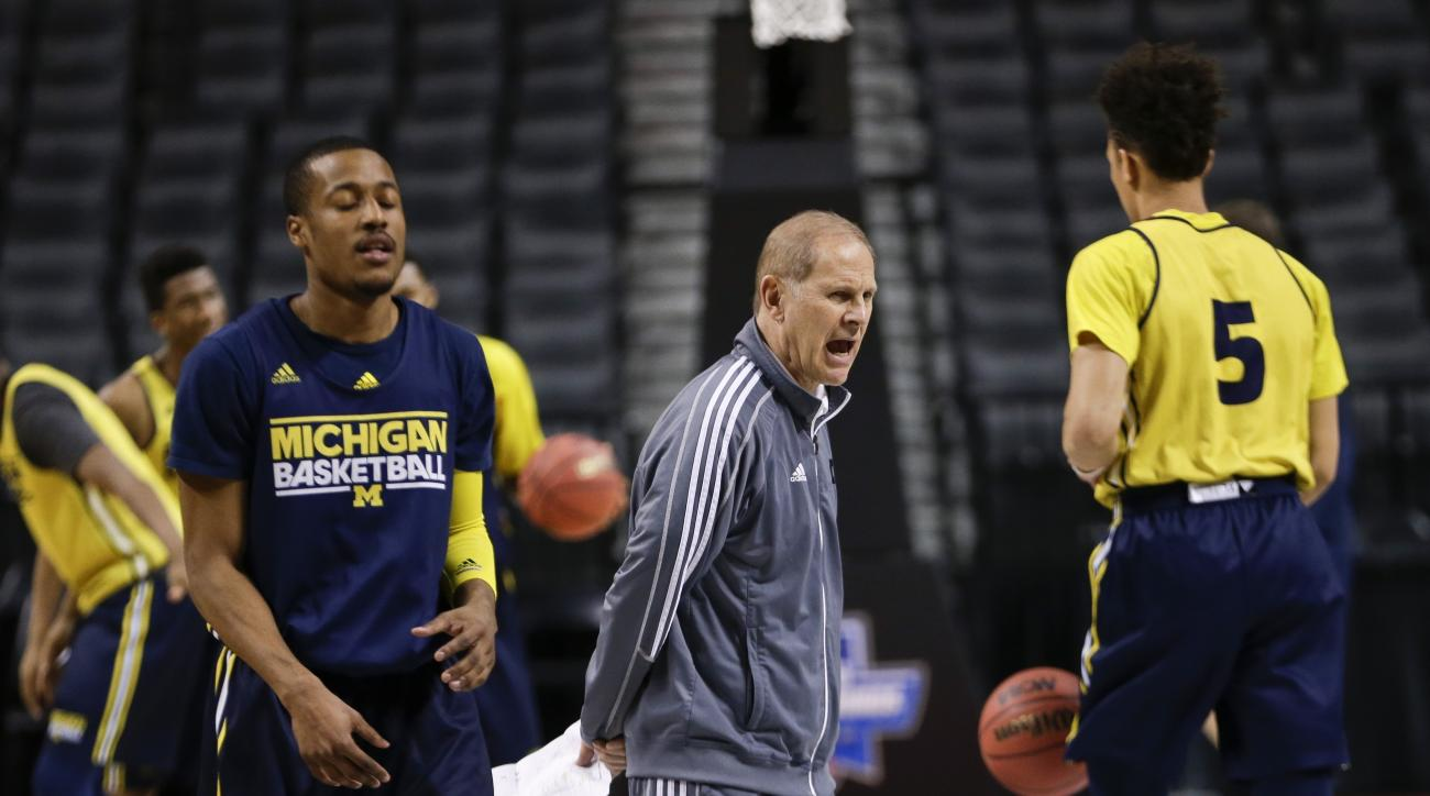 Michigan head coach John Beilein calls out to his team during practice for a first-round men's college basketball game against Notre Dame in the NCAA Tournament Thursday, March 17, 2016, in New York. (AP Photo/Frank Franklin II)