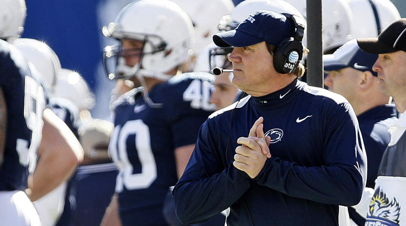 FILE - In this Jan. 2, 2012, file photo, Penn State interim head coach Tom Bradley walks the sidelines during the first half of the TicketCity Bowl NCAA college football game against Houston in Dallas. Bradley has been defensive coordinator at UCLA for le