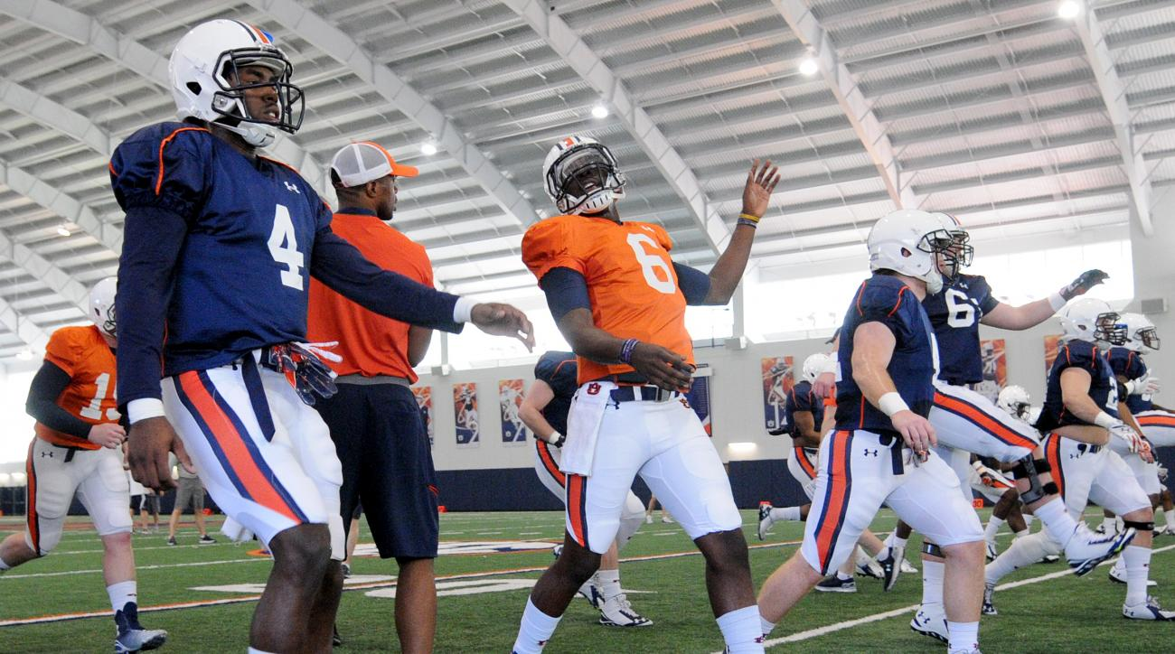 In this March 17, 2015, photo, Auburn wide receiver Jason Smith (4) and quarterback Jeremy Johnson (6) stretch during spring football practice in Auburn, Ala. Auburn newcomer Jason Smith is swiftly making the transition from junior college quarterback to