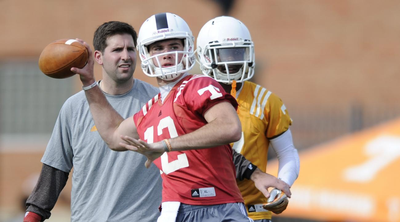 In this  Tuesday, March 24, 2015 photo, Tennessee freshman quarterback Quinten Dormady practices in Knoxville, Tenn. (Adam Lau/Knoxville News Sentinel via AP)