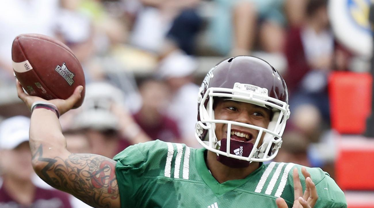 Mississippi State Maroon quarterback Dak Prescott (15) passes against the White team during their spring NCAA college football game, Saturday, April 18, 2015, in Starkville, Miss. (AP Photo/Rogelio V. Solis)