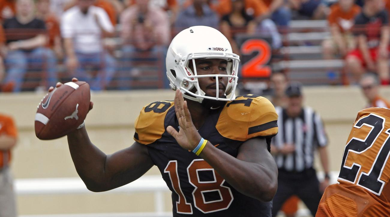 Texas quarterback Tyrone Swoopes (18) looks to throw during the first quarter of Texas' Orange and White spring NCAA college football game, Saturday, April 18, 2015, in Austin, Texas. (AP Photo/Michael Thomas)