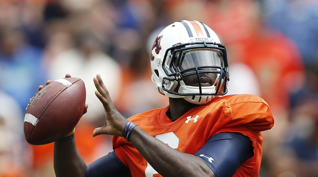 Auburn quarterback Jeremy Johnson (6) looks to pass during the first half during their spring NCAA college football game, Saturday, April 18, 2015, in Auburn, Ala. (AP Photo/Brynn Anderson)