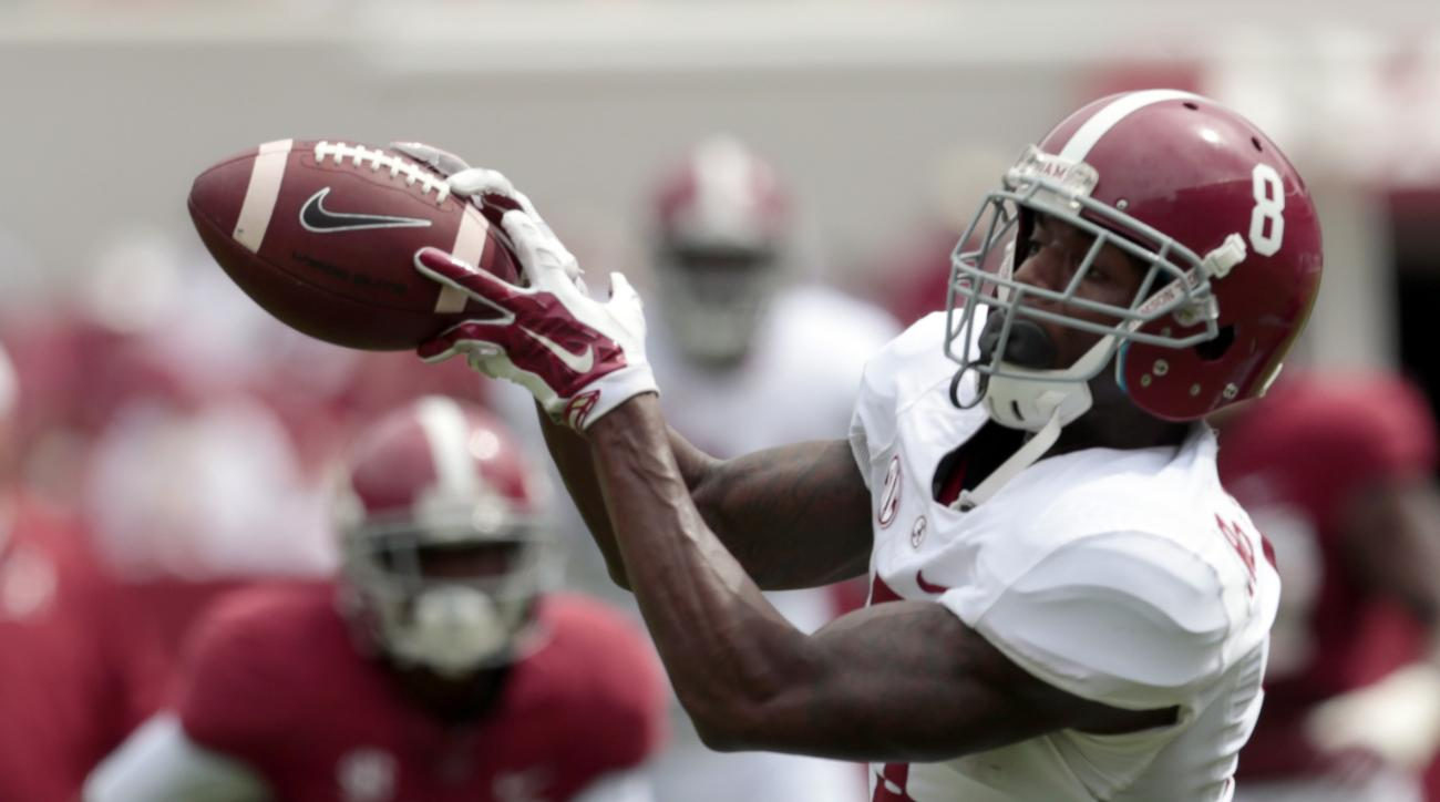Alabama wide receiver Robert Foster (8) catches a pass during the first half of Alabama's spring NCAA college football game, Saturday, April 18, 2015, in Tuscaloosa, Ala. (AP Photo/Butch Dill)