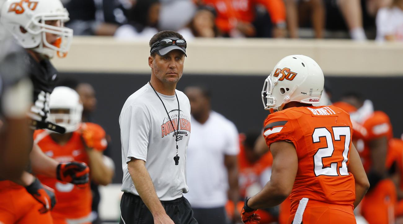 Oklahoma State head coach Mike Gundy watches in the first half of the Oklahoma State NCAA college spring football game Stillwater, Okla, Saturday, April 18, 2015. (AP Photo/Sue Ogrocki)