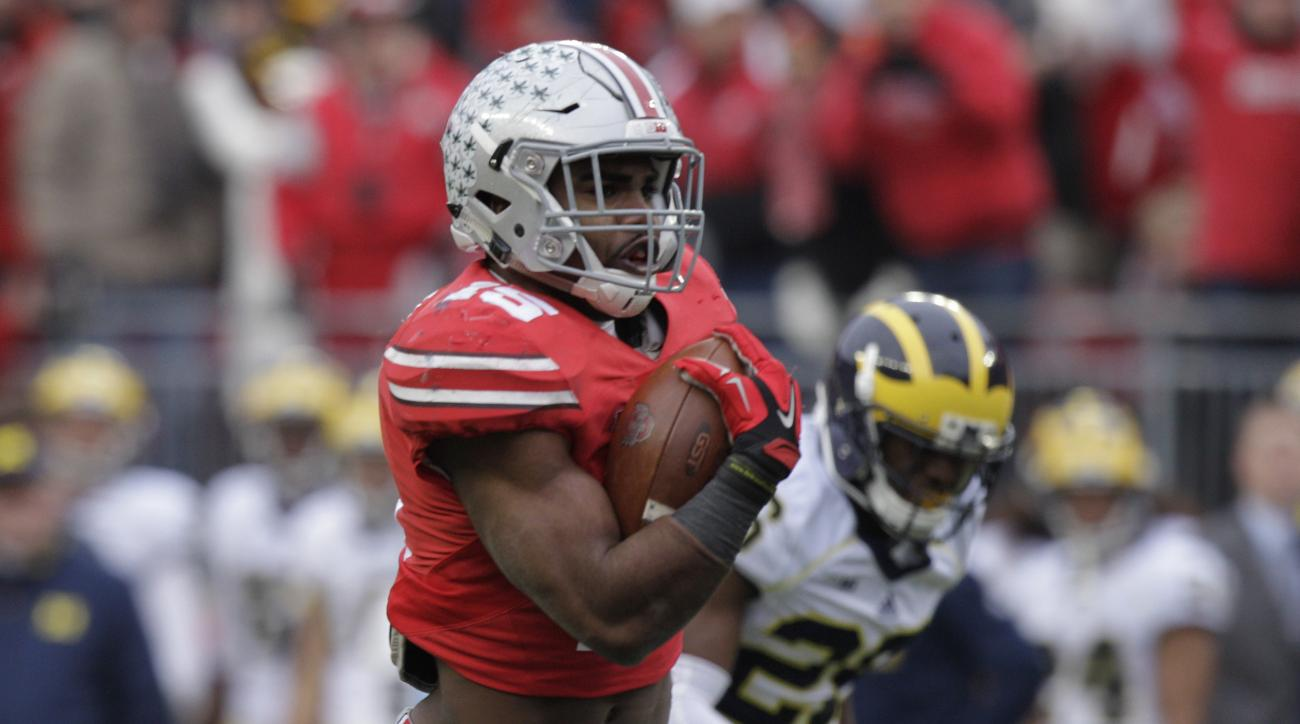 FILE - In this Nov. 29, 2014, file photo, Ohio State running back Ezekiel Elliott carries the ball against Michigan during an NCAA college football game in Columbus, Ohio. Elliott won the AAU Sullivan Award on Sunday, April 19, 2015, as the most outstandi