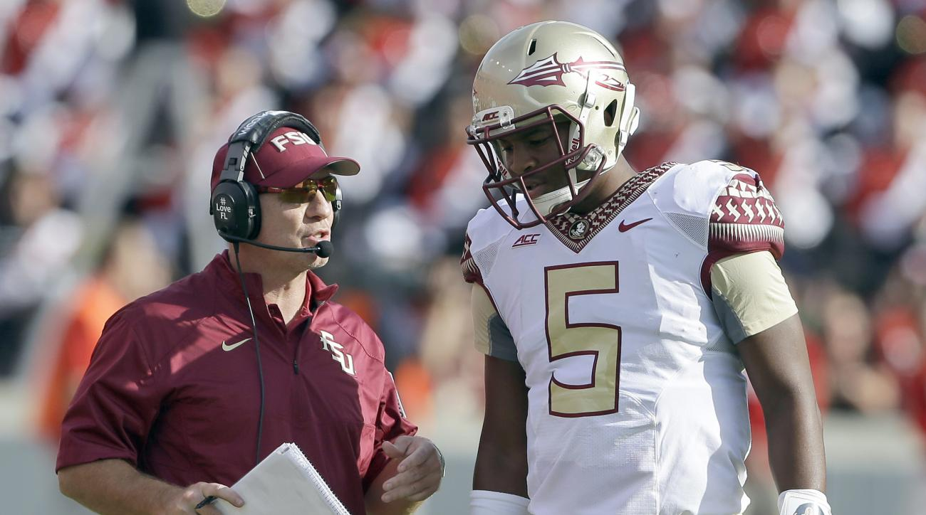 FILE - In this Sept. 27, 2014 file photo, Florida State quarterback Jameis Winston (5) and coach Jimbo Fisher talk during the first half of an NCAA college football game against North Carolina State in Raleigh, N.C. Fisher says former quarterback Jameis W