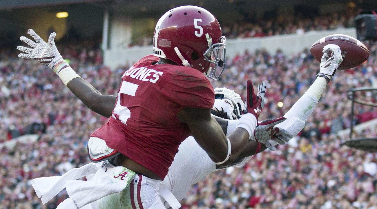Alabama defensive back Cyrus Jones (5) interrupts a pass intended for Mississippi State wide receiver De'Runnya Wilson during the first half of an NCAA college football game Saturday, Nov. 15, 2014, in Tuscaloosa, Ala. (AP Photo/Brynn Anderson)