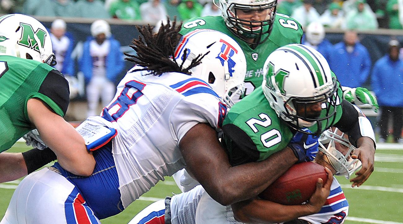 Marshall's Steward Butler runs the ball against Louisiana Tech during the Conference USA championship NCAA college football game in Huntington, W.Va., Saturday Dec. 6, 2014. (AP Photo/Chris Tilley)