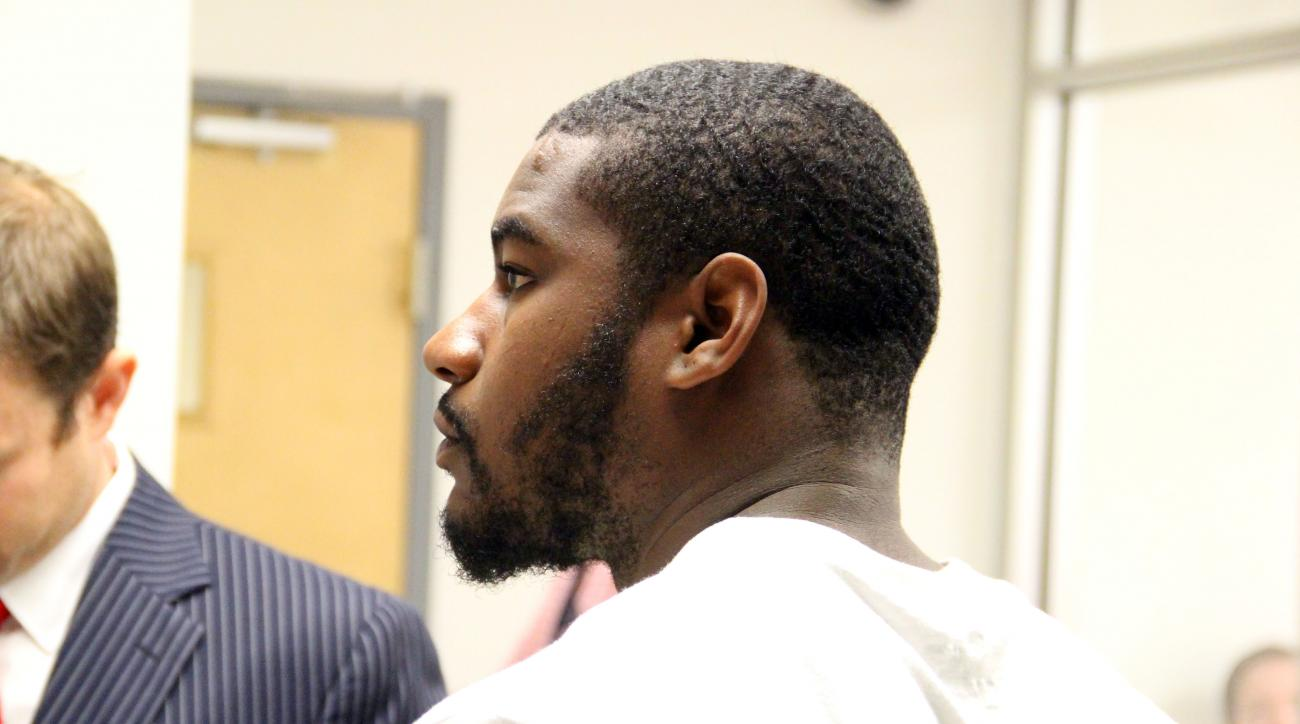 Marshall University running back Steward Butler appears in Cabell County Magistrate Court in Huntington, W. Va., Wednesday, May 6, 2015. Huntington police say Butler has been charged in the beating of two gay men.  (Curtis Johnson/The Herald-Dispatch via