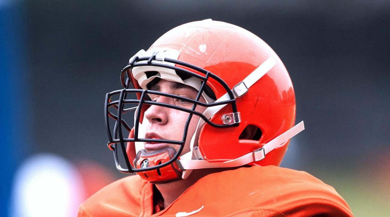 In this Aug. 7, 2013 photo, University of Illinois football player Simon Cvijanovic practices at Memorial Stadium in Champaign, Ill. Cvijanovic used a long series of Twitter messages Sunday May 10, 2015, to accuse coach Tim Beckman and some staff members