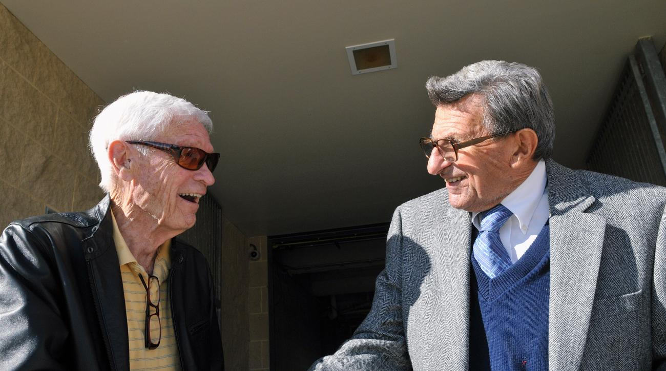 FILE - In this Nov. 9, 2010, file photo, Fran Fisher, left, congratulates Penn State coach Joe Paterno, on his 400th career coaching win after his weekly NCAA college football news conference in State College, Pa. Fran Fisher, who broadcast Penn State foo