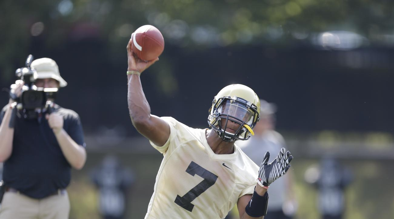 Vanderbilt quarterback Josh Grady throws during an NCAA college football practice on Thursday, Aug. 1, 2013, in Nashville, Tenn. (AP Photo/Mark Humphrey)