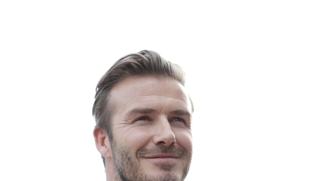 David Beckham speaks during a news conference, Monday, March 24, 2014 in Miami. Beckham's architects and advisers have recommended the Port of Miami as the stadium site for the Major League Soccer expansion team that will be owned by the former English na