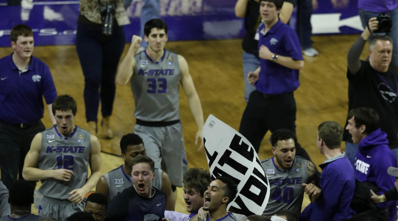 Kansas State players and fans celebrate following an NCAA college basketball game against Kansas at Bramlage Coliseum in Manhattan, Kan., Monday, Feb. 23, 2015. Kansas State defeated Kansas 70-63. (AP Photo/Orlin Wagner)