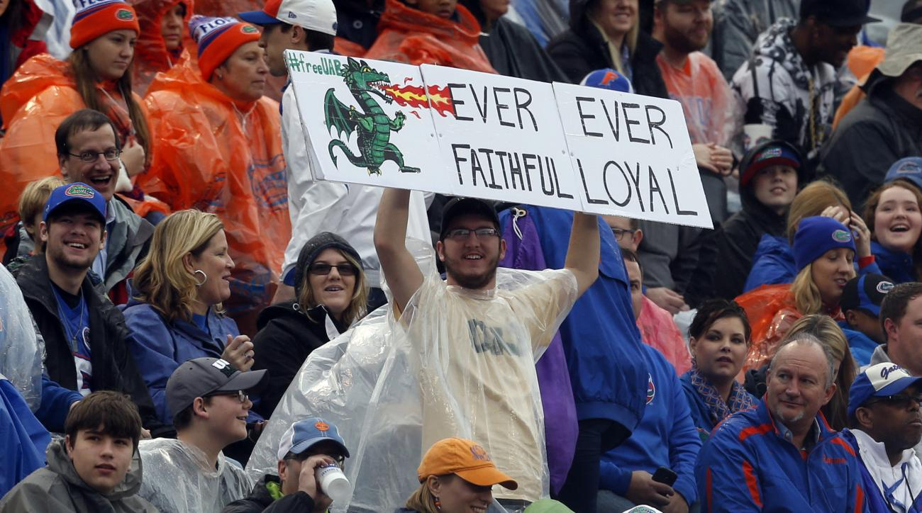 A lone UAB fan declares his loyalty for the terminated football program during the first half of the Birmingham Bowl NCAA college football game between Florida and East Carolina, Saturday, Jan. 3, 2015, in Birmingham, Ala. (AP Photo/Butch Dill)