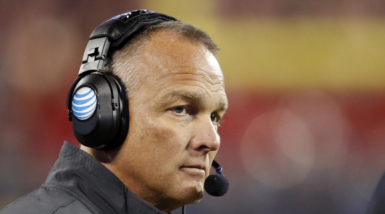 FILE - In this Dec. 20, 2014, file photo, Georgia coach Mark Richt watches the first half of the Belk Bowl NCAA college football game against Louisville in Charlotte, N.C. Richt says he hopes discression is used in the newly passed SEC rule which blocks i