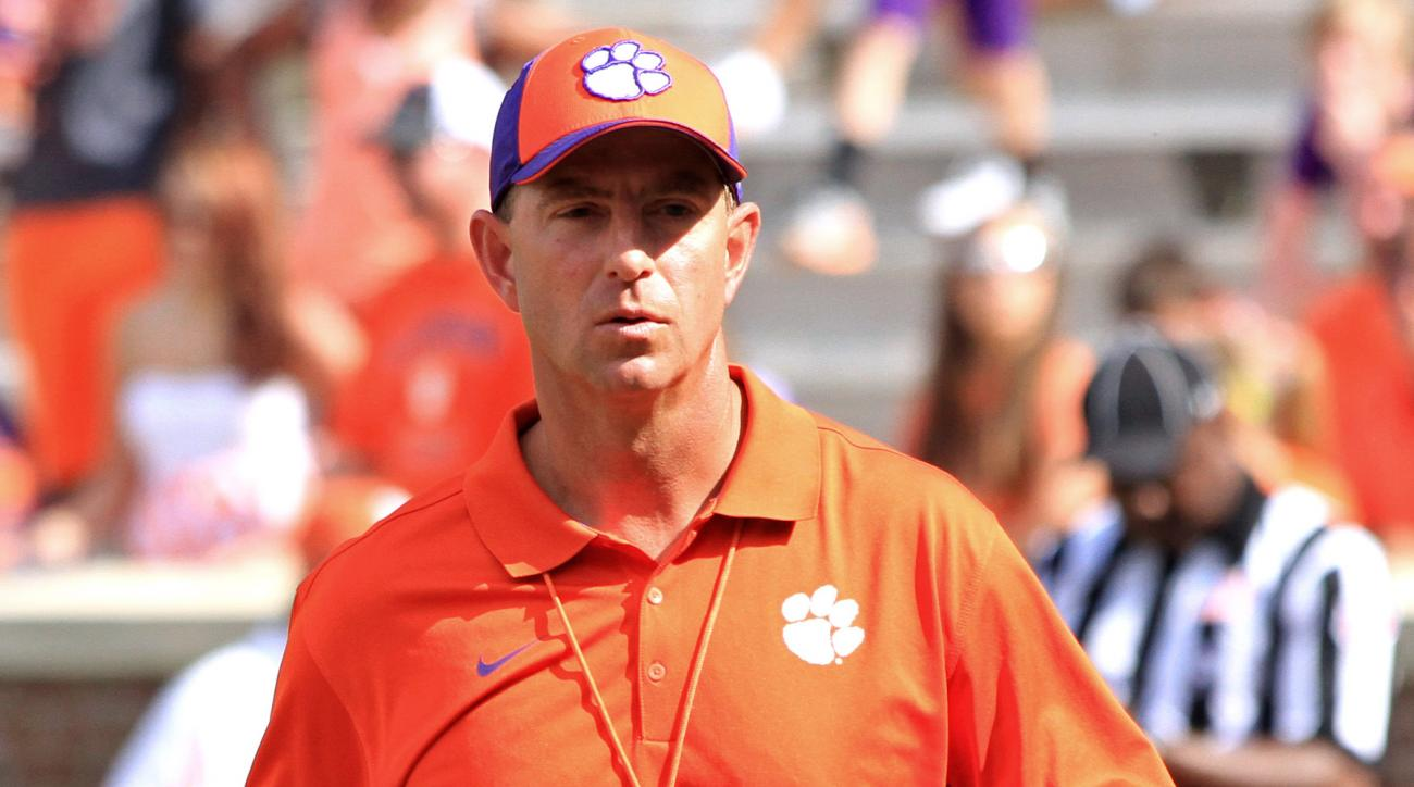 FILE - In this April 11, 2015, file photo, Clemson coach Dabo Swinney walks the field during their spring NCAA college football game at Memorial Stadium in Clemson, S.C. Clemson lost all four starting linemen on the nation's No. 1 defense. But coach Dabo