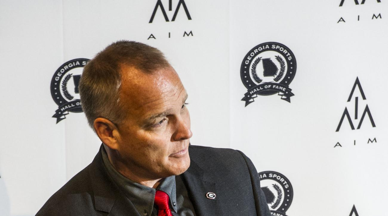 "Georgia head football coach Mark Richt answers questions during the annual Pigskin Preview, Tuesday, June 2, 2015, at the Georgia Sports Hall of Fame in Macon, Ga. Richt hopes there is room for ""discretion"" in the SEC's new rule which blocks schools from"