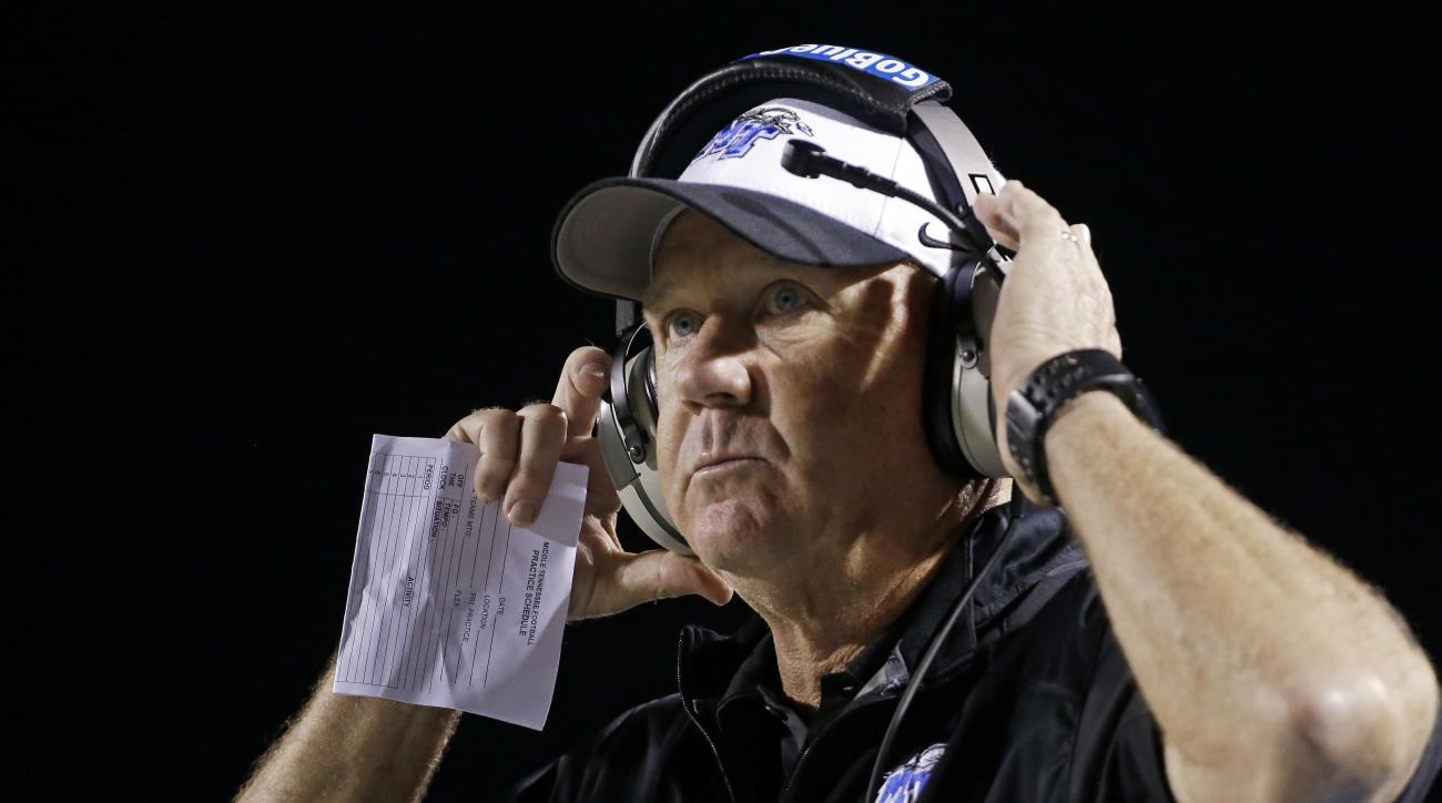 FILE - In this Sept. 13, 2014, file photo, Middle Tennessee head coach Rick Stockstill watches from the sideline during the fourth quarter in an NCAA college football game against Western Kentucky in Murfreesboro, Tenn. Stockstill has agreed to postpone t