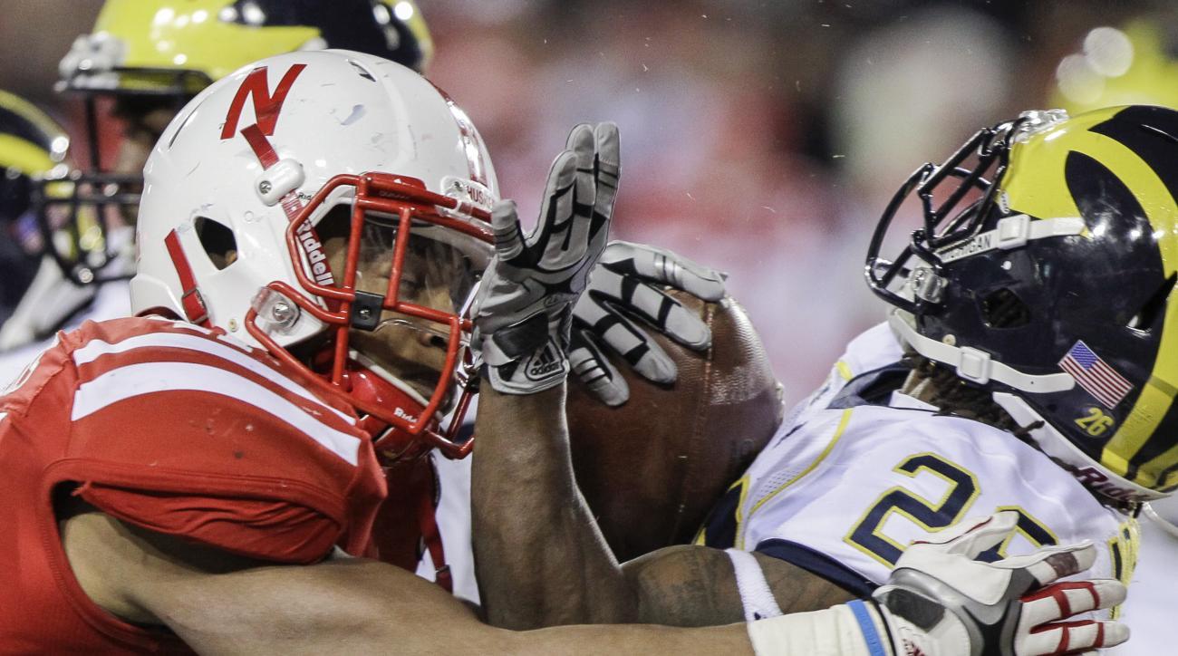 Michigan's Kenny Demens, right, is tackled by Nebraska's David Santos in the second half of an NCAA college football game in Lincoln, Neb., Saturday, Oct. 27, 2012. Nebraska won 23-9. (AP Photo/Nati Harnik)