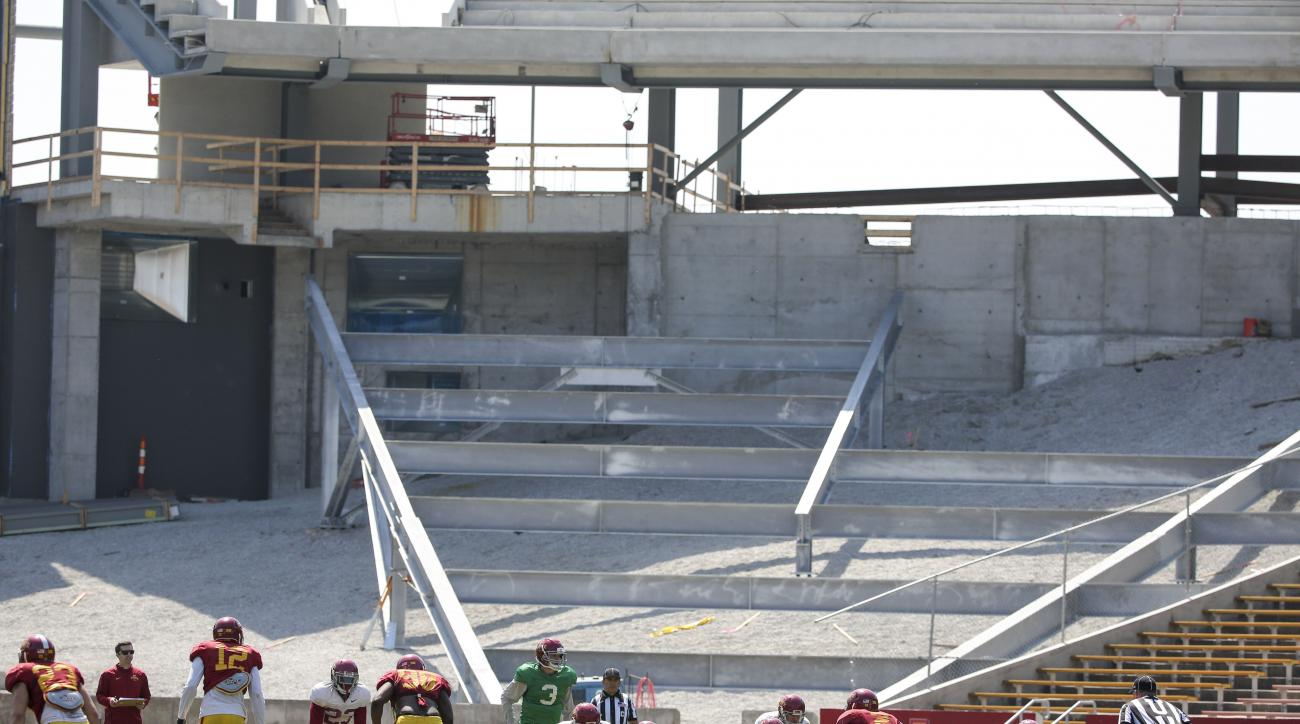 FILE - In this April 11, 2015, file photo, construction work continues in the south end zone of Jack Trice Stadium as the Iowa State football team playes during their spring NCAA college football game in Ames, Iowa. Guess who will have the Big 12's third-