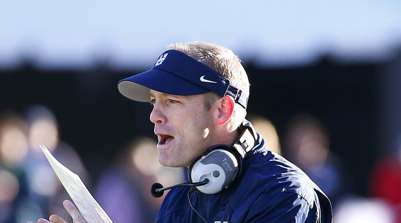 Utah State head coach Matt Wells cheers on his players after a touchdown against UTEP during the second half of the New Mexico Bowl NCAA college football game Saturday, Dec. 20, 2014, in Albuquerque, N.M.  Utah State defeated UTEP 21-6. (AP Photo/Ross D.