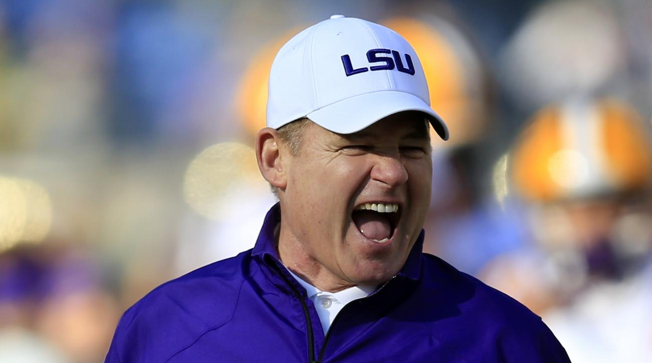 LSU head coach Les Miles watches his players warm up before the Music City Bowl NCAA college football game against Notre Dame Tuesday, Dec. 30, 2014, in Nashville, Tenn. (AP Photo/Mark Humphrey)