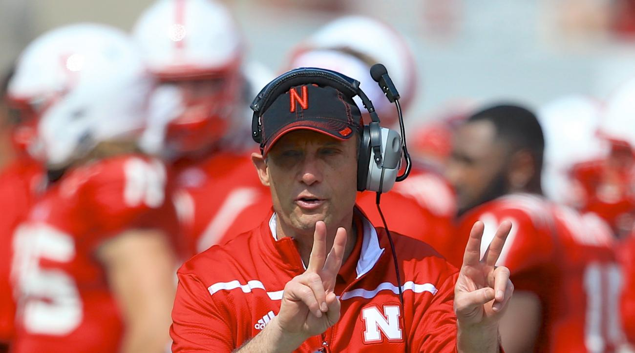 FILE - In this April 11, 2015, file photo, Nebraska head coach Mike Riley signals during the annual NCAA college football Red-White spring game in Lincoln, Neb. Riley is a month away from opening practice for his first season coaching at Nebraska. (AP Pho