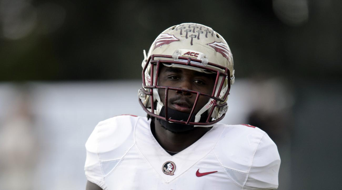 Florida State running back Dalvin Cook walks during a break during NCAA college football practice in Carson, Calif., Tuesday, Dec. 30, 2014. Florida State is scheduled to play Oregon in the Rose Bowl NCAA college football playoff semifinal on New Year's D