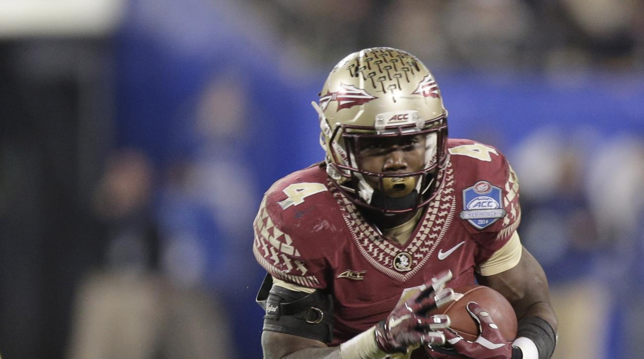 FILE - In this Saturday, Dec. 6, 2014 file photo, Florida State's Dalvin Cook (4) runs against Georgia Tech during the second half of the Atlantic Coast Conference championship NCAA college football game in Charlotte, N.C. Florida State is suspending runn