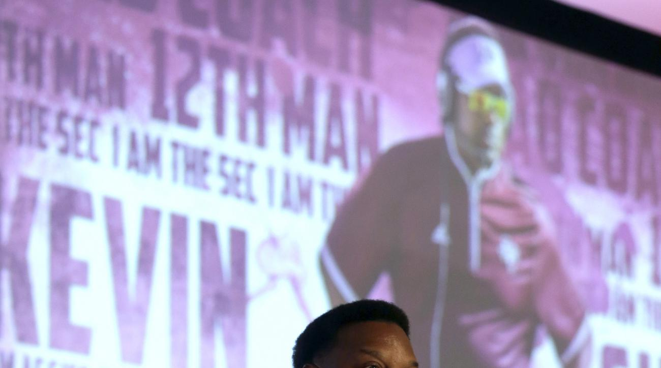 Texas A&M coach Kevin Sumlin speaks to the media at the Southeastern Conference NCAA college football media days, Tuesday, July 14, 2015, in Hoover, Ala. (AP Photo/Butch Dill)