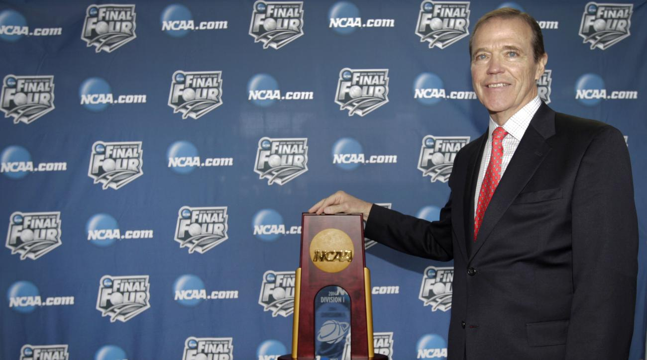 Wake Forrest University Athletic Director Ron Wellman, the Chairman of Division 1 men's basketball championship committee poses with the NCAA National Champion trophy following a Final Four news conference, Wednesday, Jan. 22, 2014, in Arlington, Texas. T