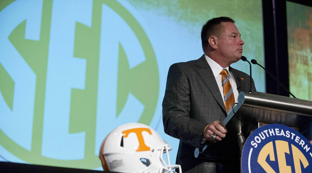 Tennessee coach Butch Jones speaks to the media at the Southeastern Conference NCAA college football media days, Tuesday, July 14, 2015, in Hoover, Ala. (AP Photo/Brynn Anderson)