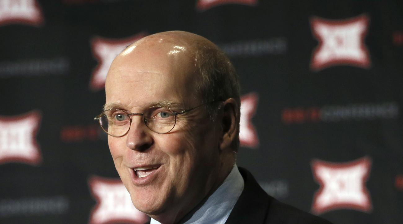 College Football Playoff Executive Director Bill Hancock addresses attendees at the NCAA college  Big 12 Conference Football Media Days Tuesday, July 21, 2015, in Dallas. (AP Photo/Tony Gutierrez)