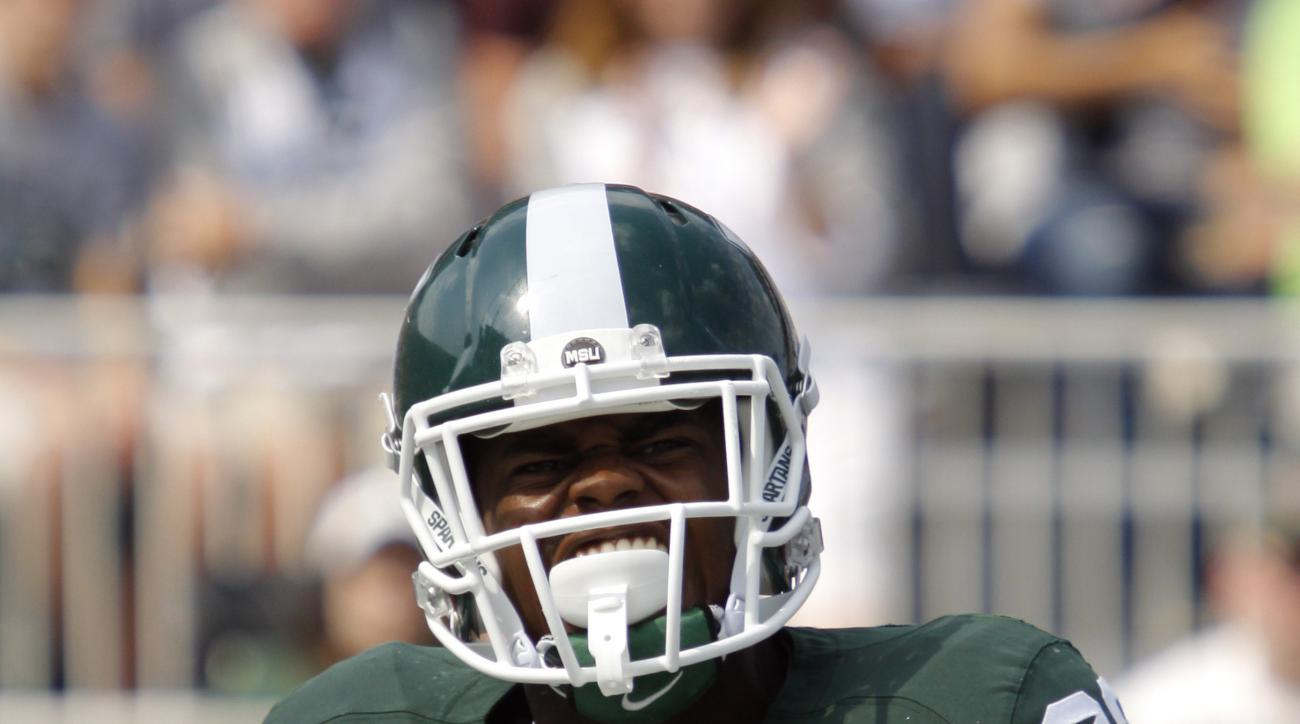 Michigan State's Delton Williams celebrate his touchdown against Eastern Michigan during the second quarter of an NCAA college football game, Saturday, Sept. 20, 2014, in East Lansing, Mich. Michigan State won 73-14. (AP Photo/Al Goldis)