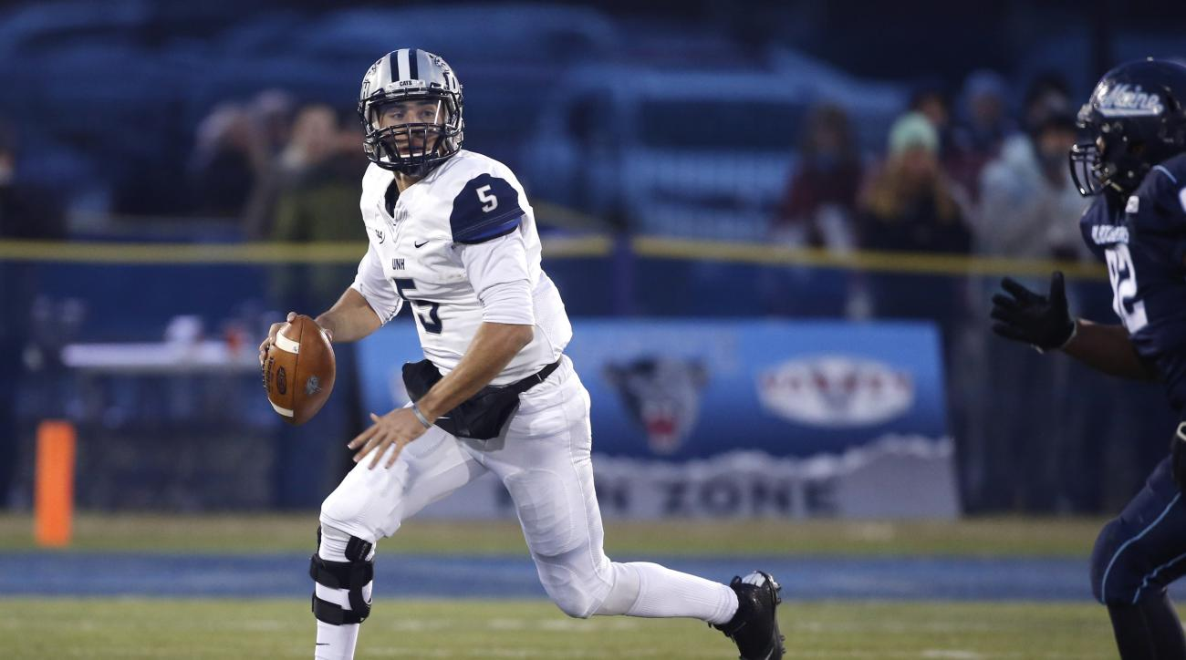 New Hampshire Wildcats quarterback Sean Goldrich (5) scrambles during the first half of an NCAA college football game agains Maine, Saturday, Nov. 22, 2014, at Alfond Stadium at the University of Maine in Orono, Maine. (AP Photo/Robert F. Bukaty)