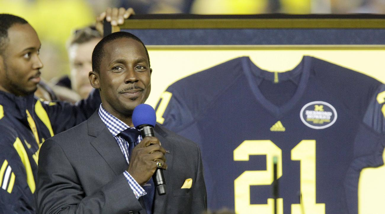 University of Michigan football great Desmond Howard, the 1991 Heiman Trophy winner, is honored before an NCAA college football game between Michigan and Notre Dame in Ann Arbor, Mich., Saturday, Sept. 10, 2011. Desmond was recognized for his recent induc