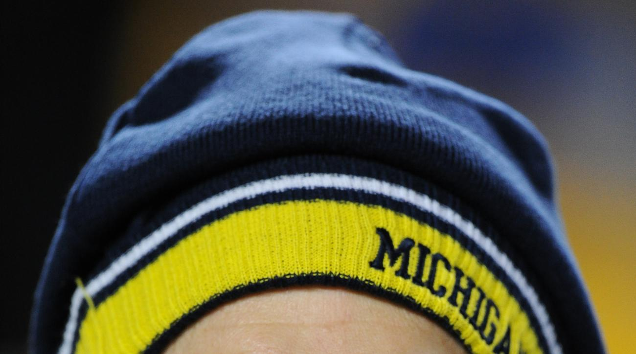 FILE- In this file photo from Jan. 3, 2015, The new Michigan football coach, Jim Harbaugh, is on the sideline before an NFL wildcard playoff football game in Pittsburgh. The pundits are talking up the Big Ten league this spring, largely because of the ach