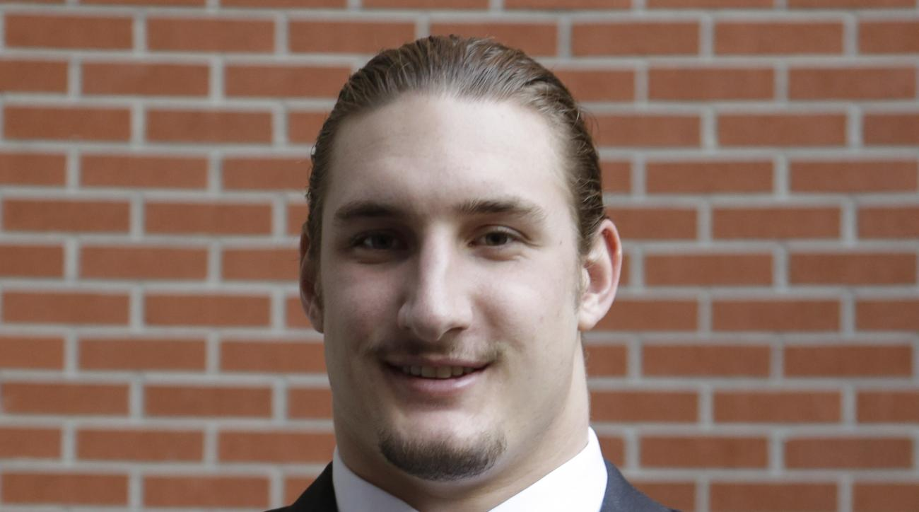 Lombardi award finalist Ohio State's Joey Bosa poses with the Lombardi trophy Wednesday, Dec. 10, 2014, in Houston. He did not win. (AP Photo/Pat Sullivan)