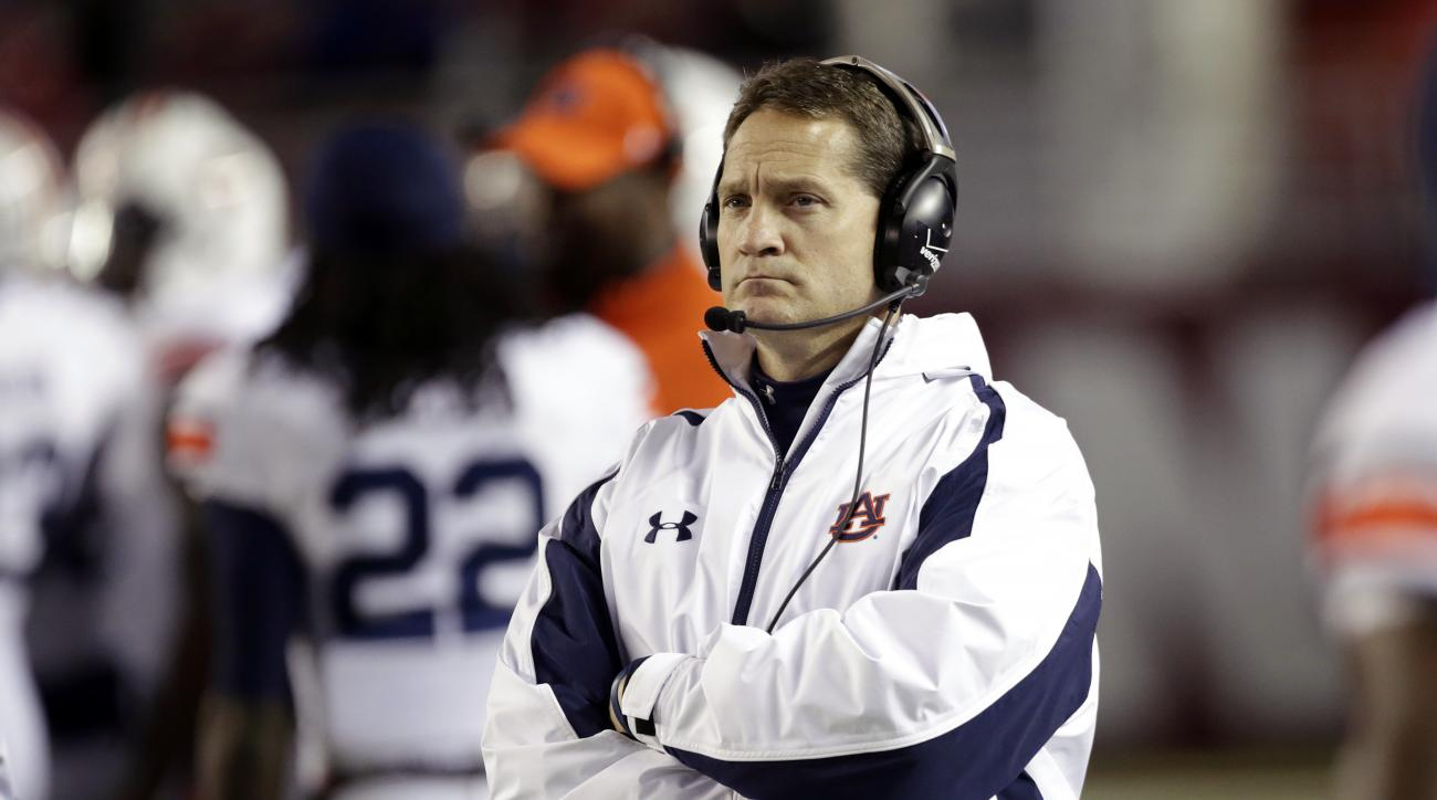 FILE - In this Nov. 24, 2012, file photo, Auburn coach Gene Chizik watches from the sidelines during the second half of an NCAA college football game against Alabama in Tuscaloosa, Ala. Chizik won a national championship as a defensive coordinator at Texa