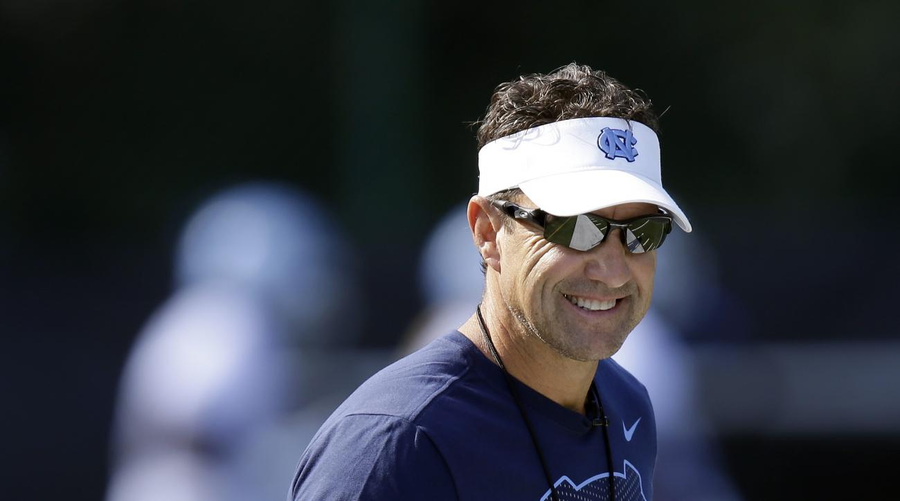 North Carolina coach Larry Fedora smiles during the team's first NCAA college football practice of the season in Chapel Hill, N.C., Monday, Aug. 3, 2015. (AP Photo/Gerry Broome)
