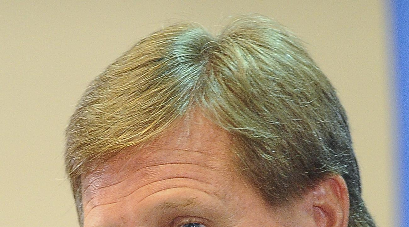 Florida coach Jim McElwain listens to a question from the media during the university's NCAA college football media day in Gainesville, Fla., Wednesday, Aug., 5, 2016. (AP Photo/Phil Sandlin)