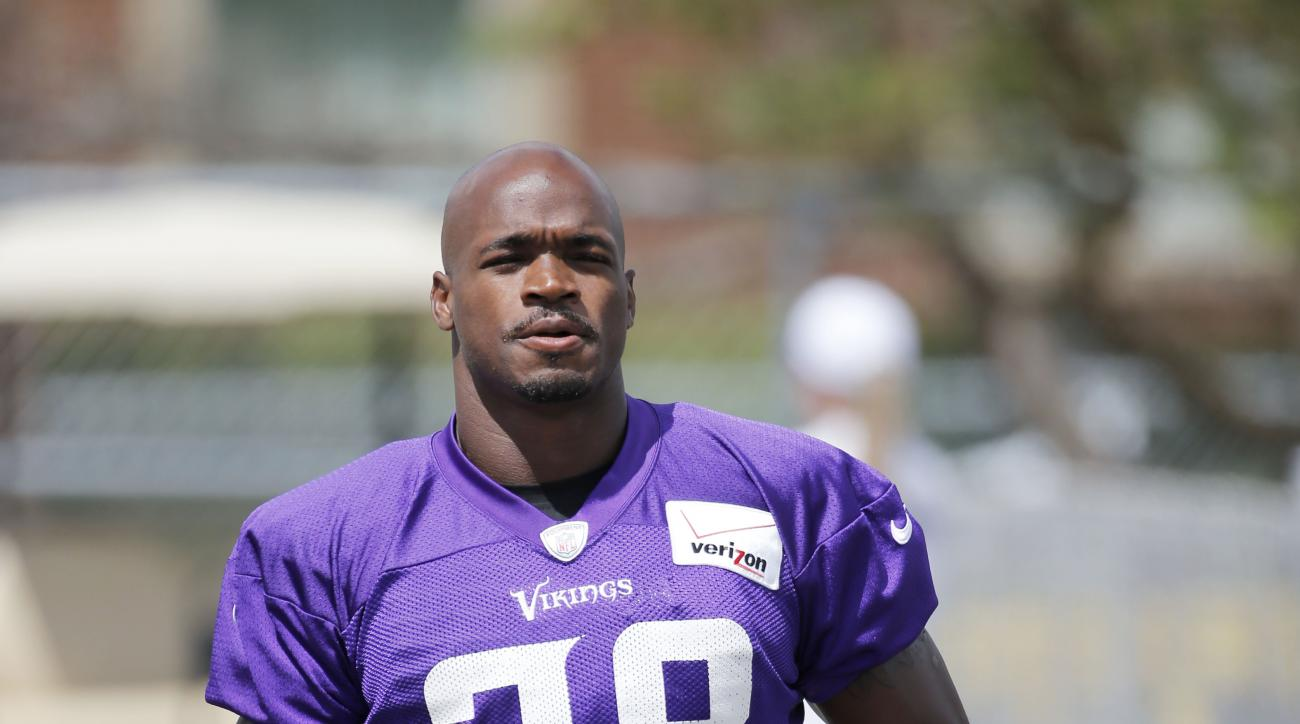 FILE - In this July 26, 2015, file photo, Minnesota Vikings running back Adrian Peterson walks to the practice fields at an NFL football training camp on the campus of Minnesota State University in Mankato, Minn. The attorney for Adrian Peterson says the