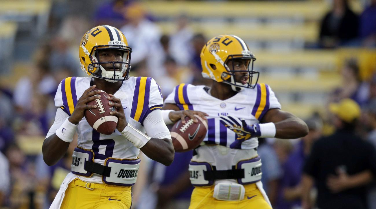 FILE - In this Oct. 18, 2014 file photo, LSU quarterback Brandon Harris (6) and quarterback Anthony Jennings (10) warm up before an NCAA college football game in Baton Rouge, La. The competition for the starting quarterback's job at LSU started Thursday,