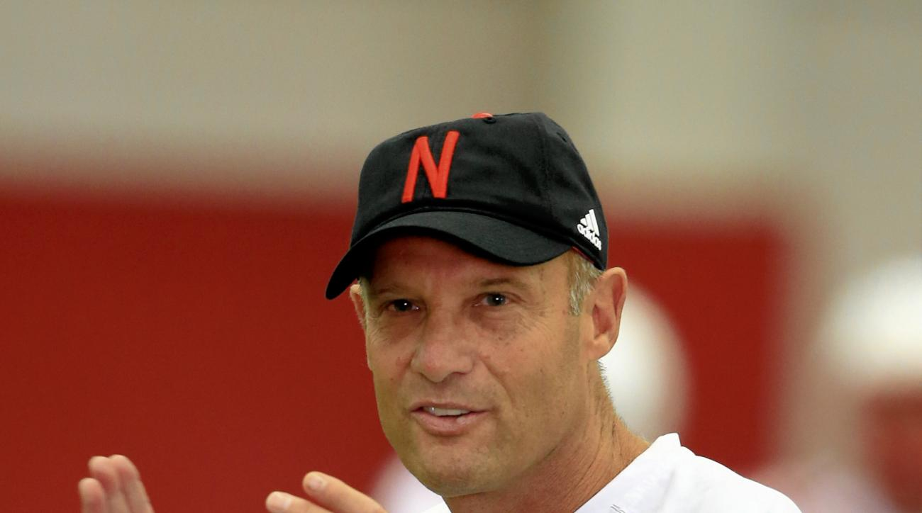 Nebraska head coach Mike Riley claps in Lincoln, Neb., Thursday, Aug. 6, 2015, as his team begins NCAA college football practice. (AP Photo/Nati Harnik)
