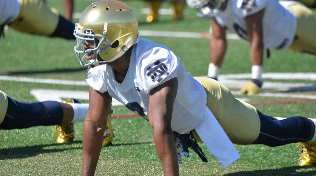 Notre Dame cornerback KeiVarae Russell does a push up during practice at an NCAA football training camp Friday, Aug. 7, 2015, in Culver, Ind. (AP Photo/Joe Raymond)